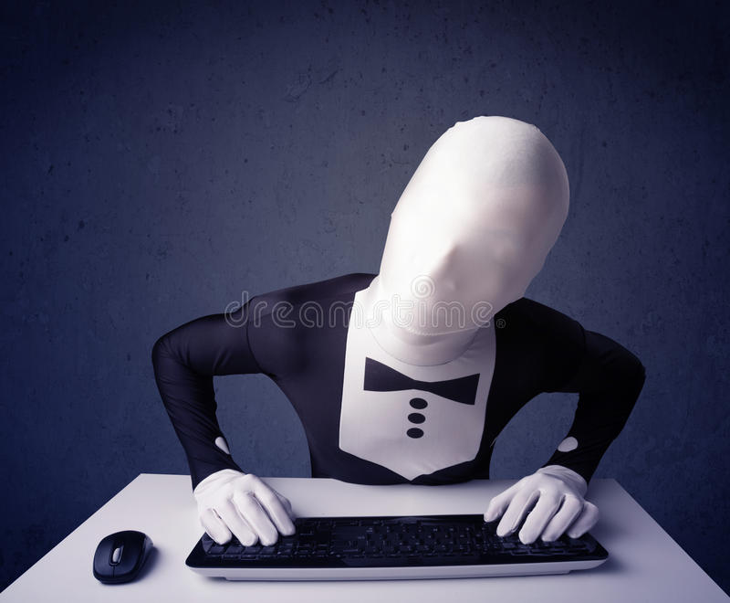 Download Man Without Identity Working With Keyboard On Blue Background Stock Photo - Image: 33469694