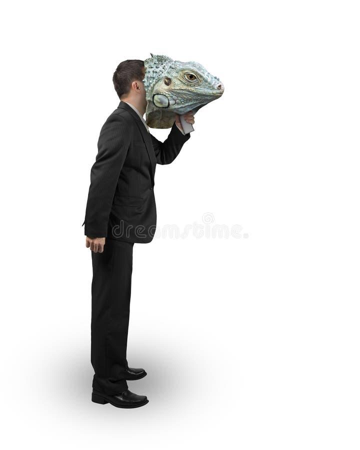 Man with iguana mask stock image
