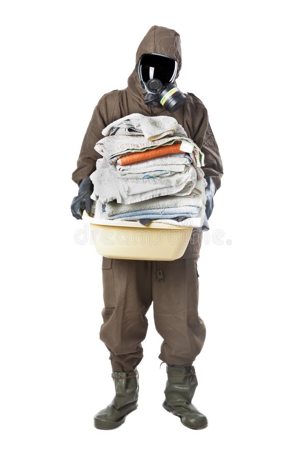 Free Man In Hazard Suit Holding Dirty Towels And Looking At The Camera Royalty Free Stock Image - 30790406