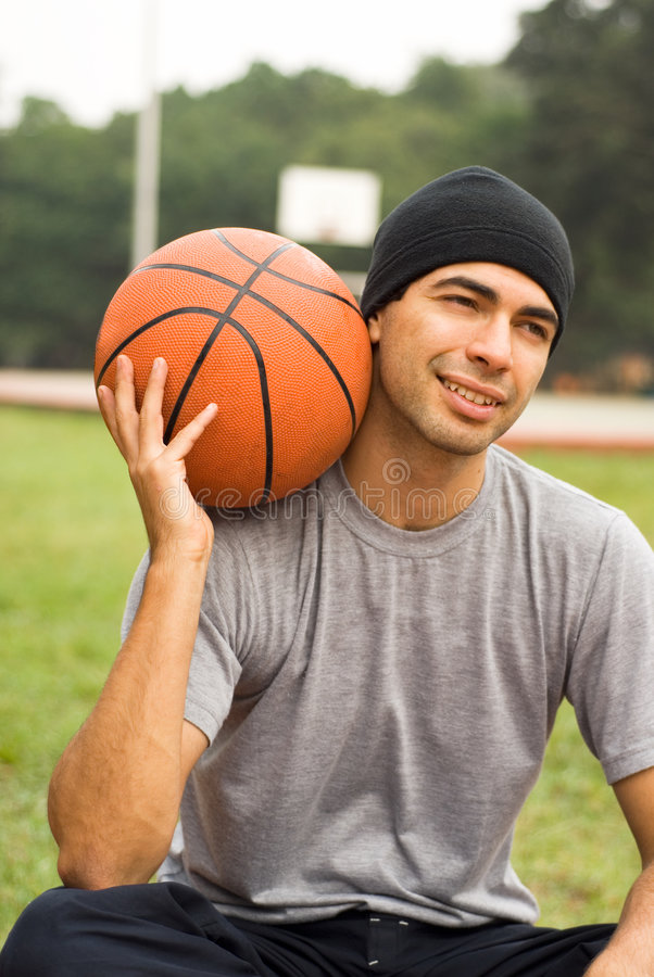 Free Man In Park Holding Basketball-Vertical Stock Photos - 5570173