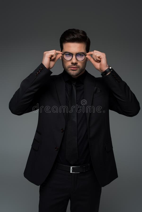 Free Man In Stylish Black Suit Taking Off Glasses Royalty Free Stock Image - 119824036