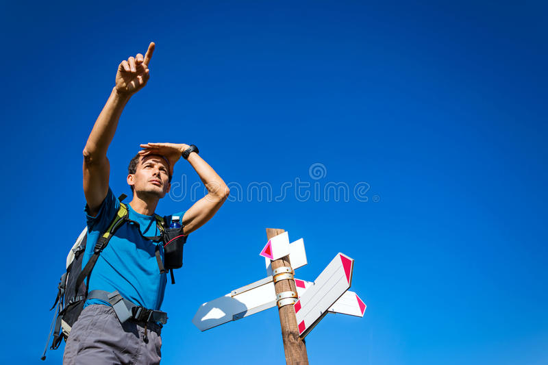 Man indicating direction at the crossroad royalty free stock images