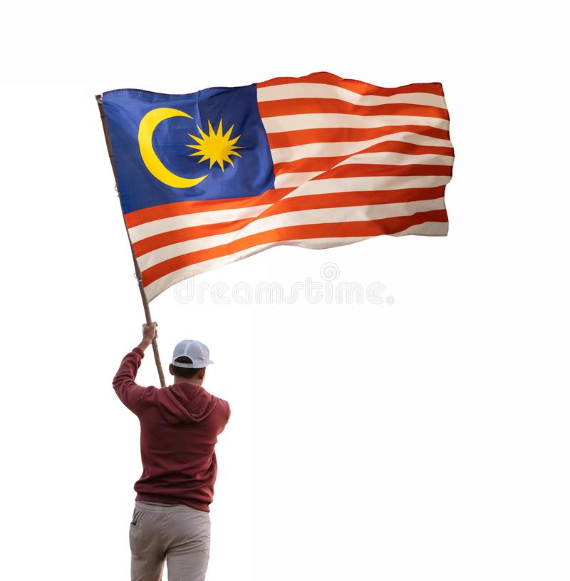 Man with indonesian flag isolated over white. Background. shoot from the back stock photography