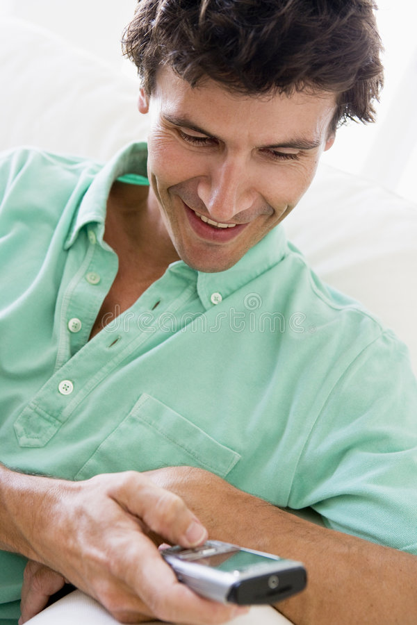 Download Man Indoors Text Messaging Stock Images - Image: 5934654