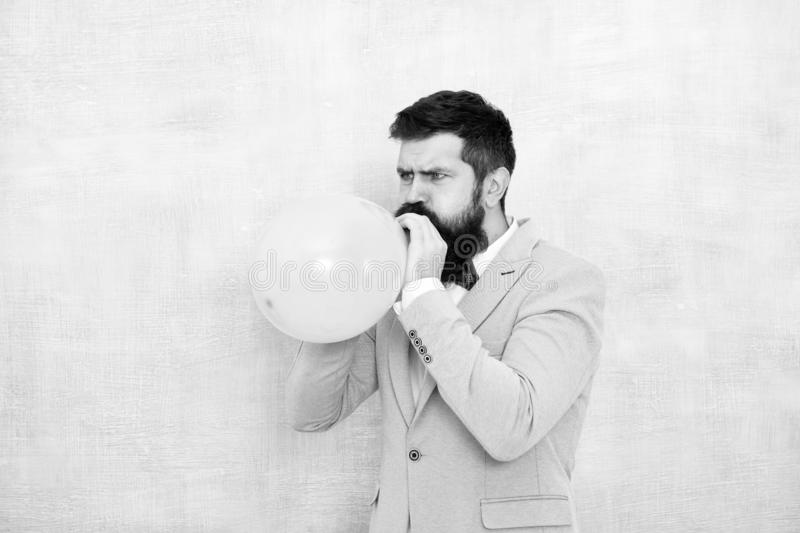 Man inflating a blue balloon. Bearded man with balloon. Happy birthday. preparation to party, celebration. Praparation. To birthday party. Birthday party stock images