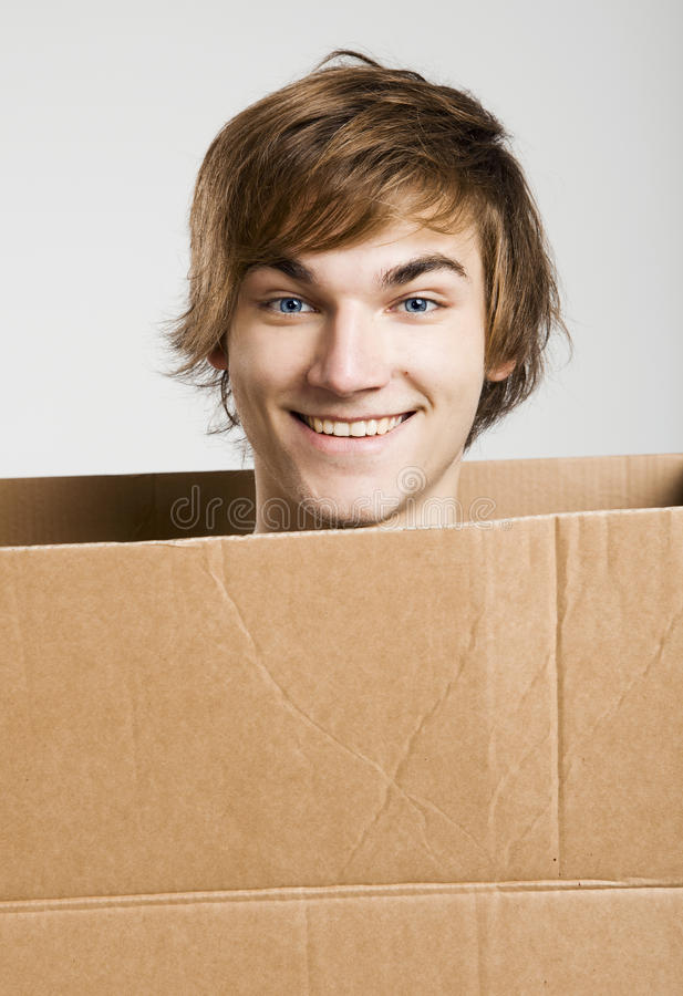 Download Man inside a card box stock photo. Image of cardboard - 26635342