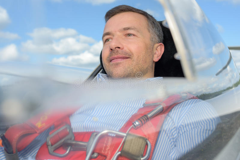 Man inside cockpit flying in glider stock photos