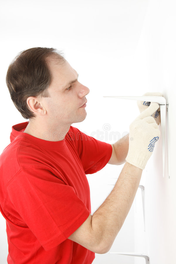 Man installing angle bracket stock photo