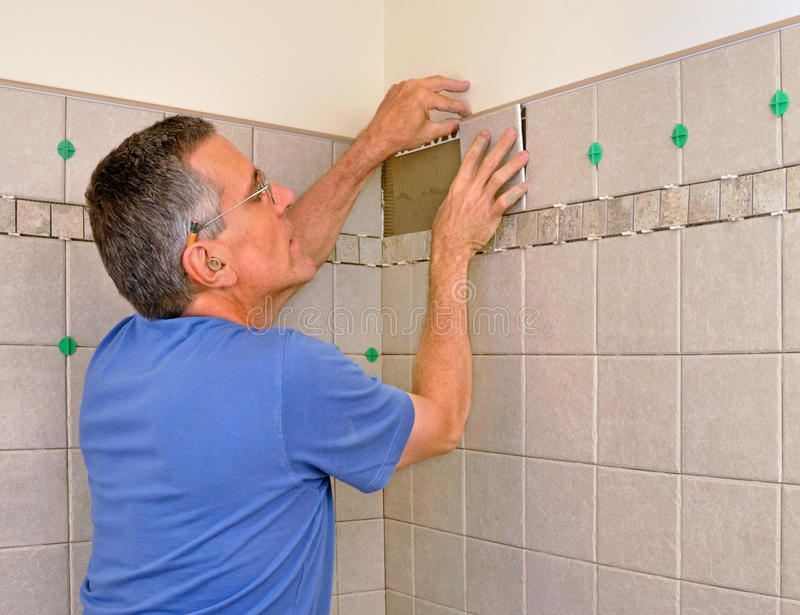 Man Installing Ceramic Tile In Bathroom Stock Photo Image Of Project Home 12672912