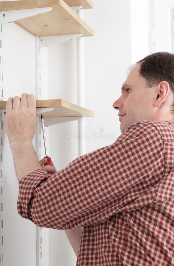 Man Installing Shelves Royalty Free Stock Photos