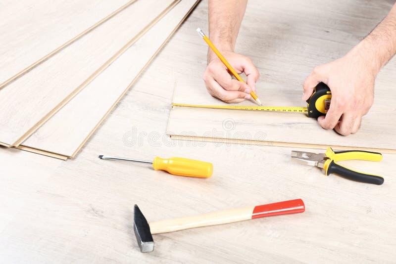 Man installing laminate flooring stock photography