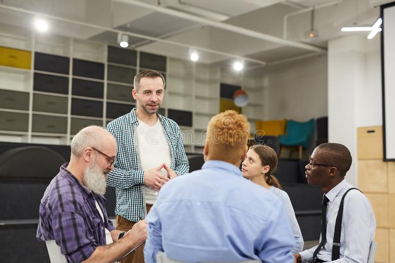 Man Introducing himself at Support Group Meeting stock image