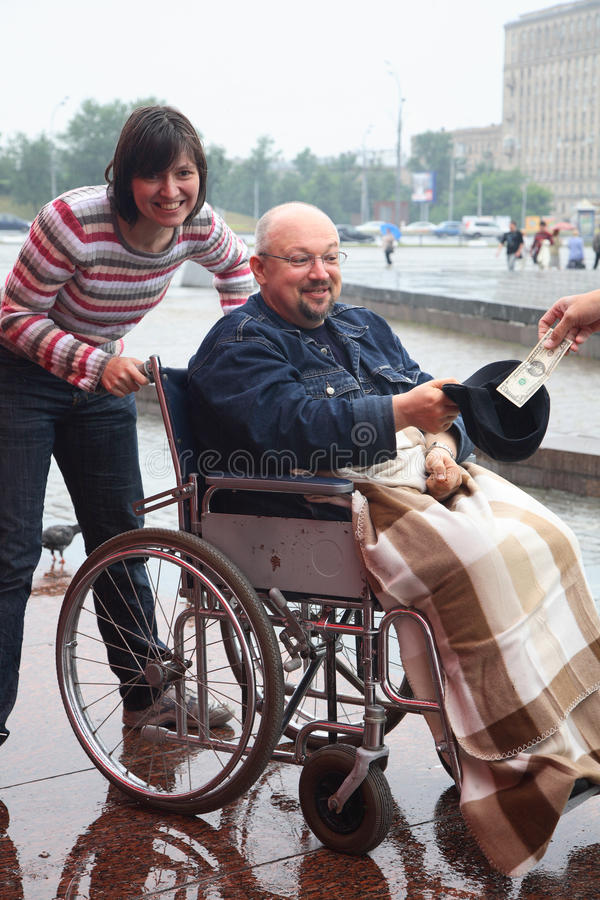 Man in an invalid carriage stock images