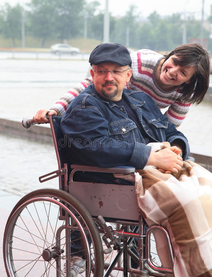 Man in an invalid carriage stock photos