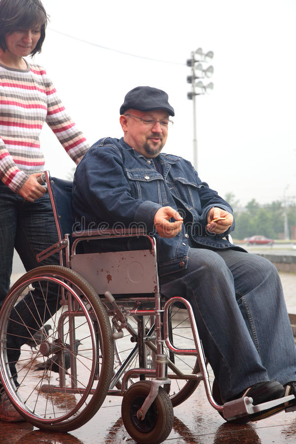 Man in an invalid carriage royalty free stock image