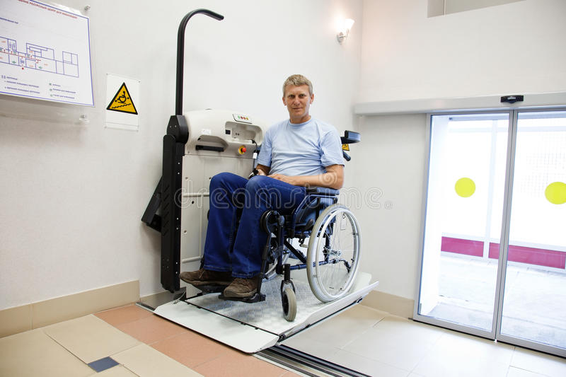 Man in an invalid chair stock image