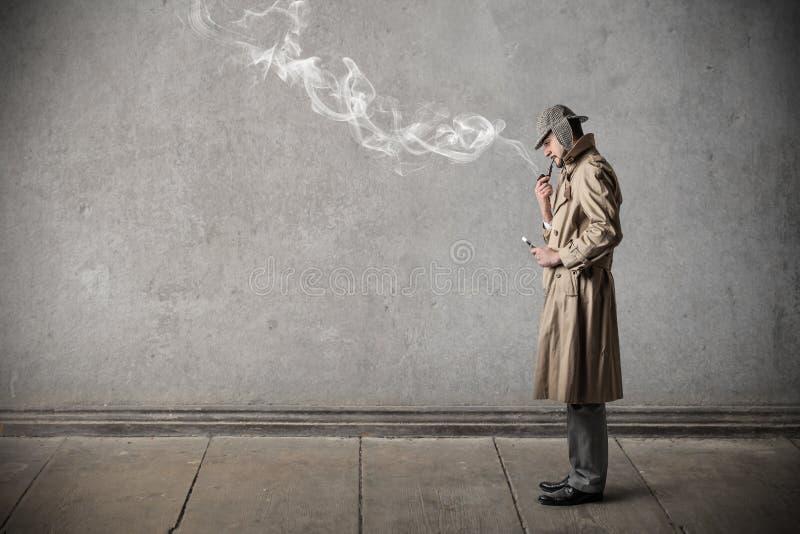 Man investigating royalty free stock image