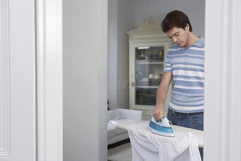 Man Ironing His Shirt royalty free stock photo