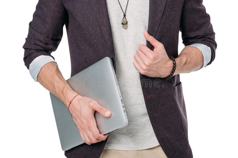 Man in jacket holding laptop isolated on white. Cropped shot of man in jacket holding laptop isolated on white royalty free stock photos