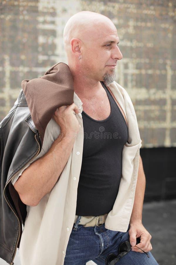 Man with jacket over shoulder
