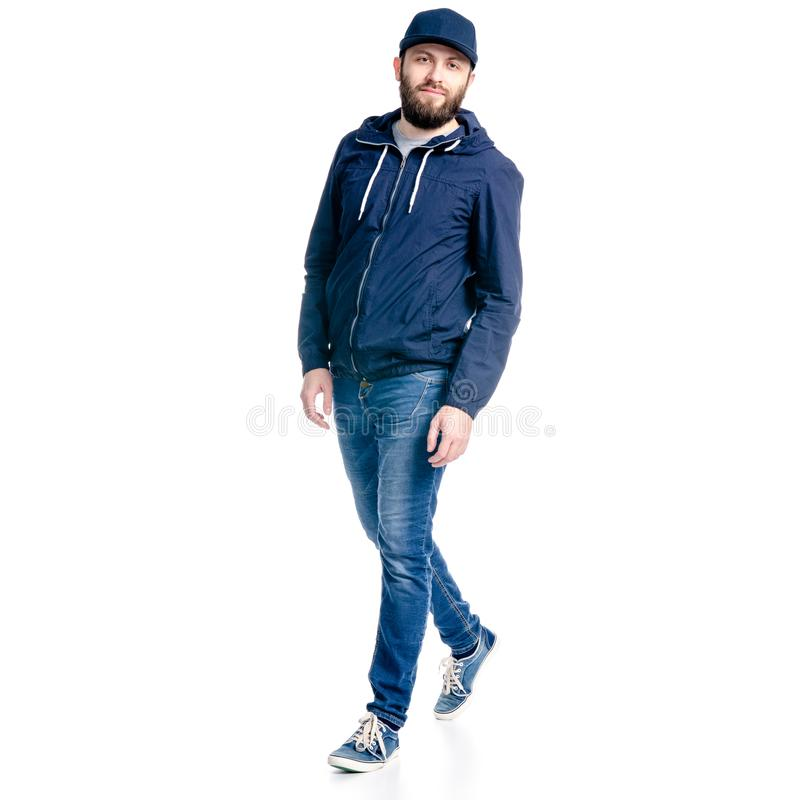 A man in jeans and jacket walking goes royalty free stock photo