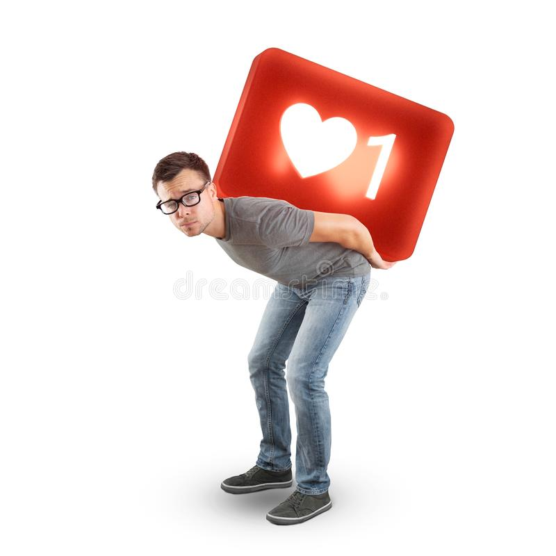 Man carrying a large social media Like Symbol - isolated on white. A man in jeans and t-shirt is carrying a 3d rendered social media like symbol on his back. Cut stock photos