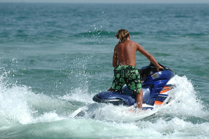Man and jet-ski stock image