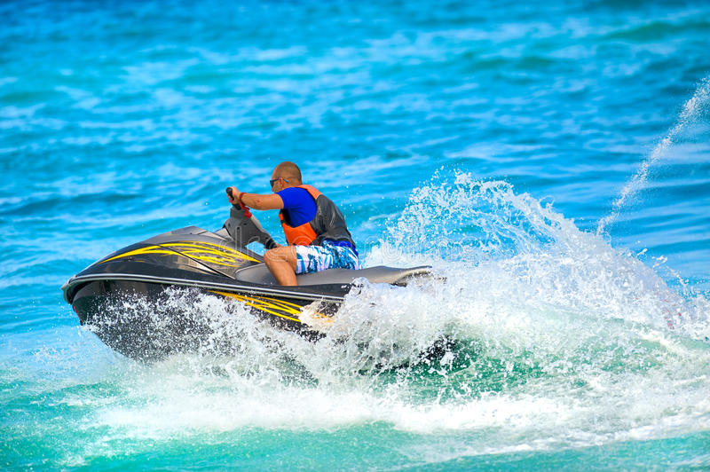 Man on jet ski royalty free stock photos