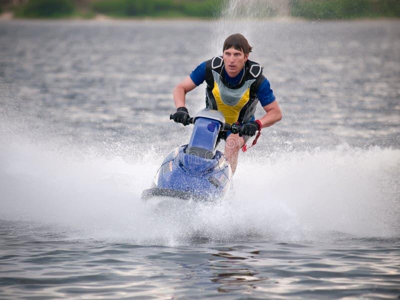 Download Man on jet ski rides fast stock photo. Image of craft - 10191672
