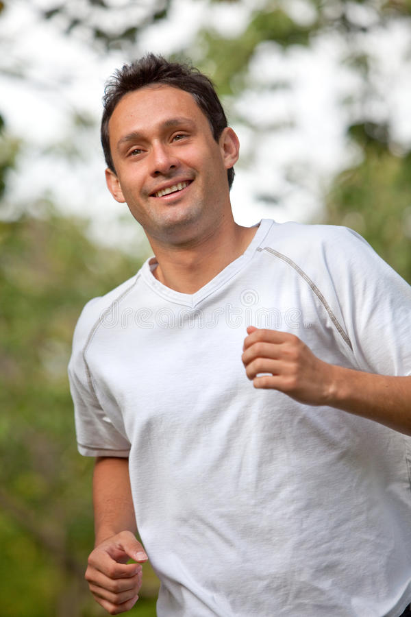 Download Man jogging stock image. Image of outside, male, athletic - 10476453