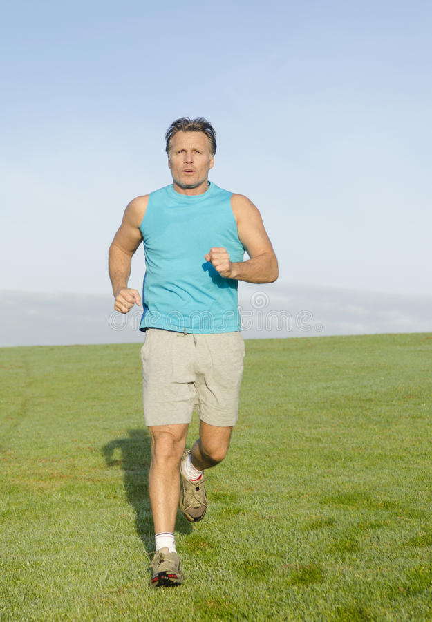 Download Man Jogging In Blue Shirt Royalty Free Stock Images - Image: 25040259