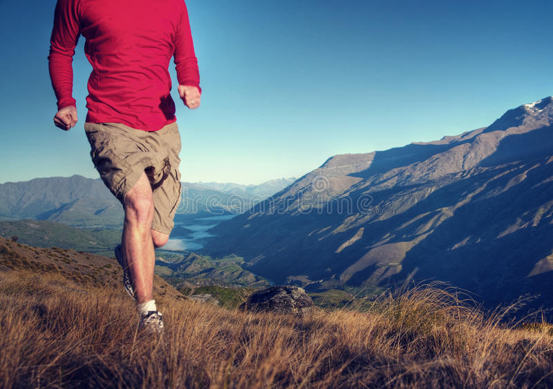 Man Jogging Mountains Exercise Wellbeing Concept.  stock photos