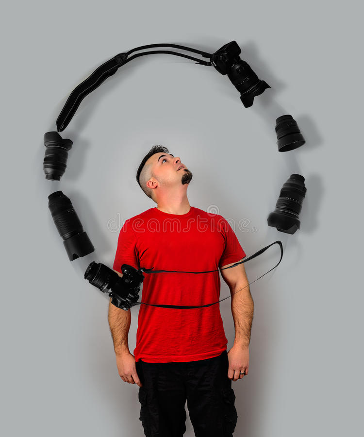 Man Juggling Cameras and Lenses with mind stock photo