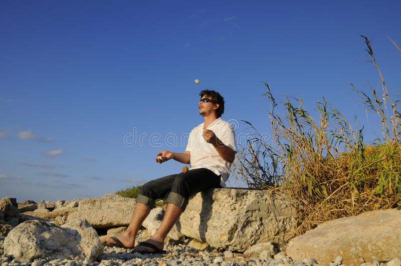 Man juggling with stones royalty free stock photography