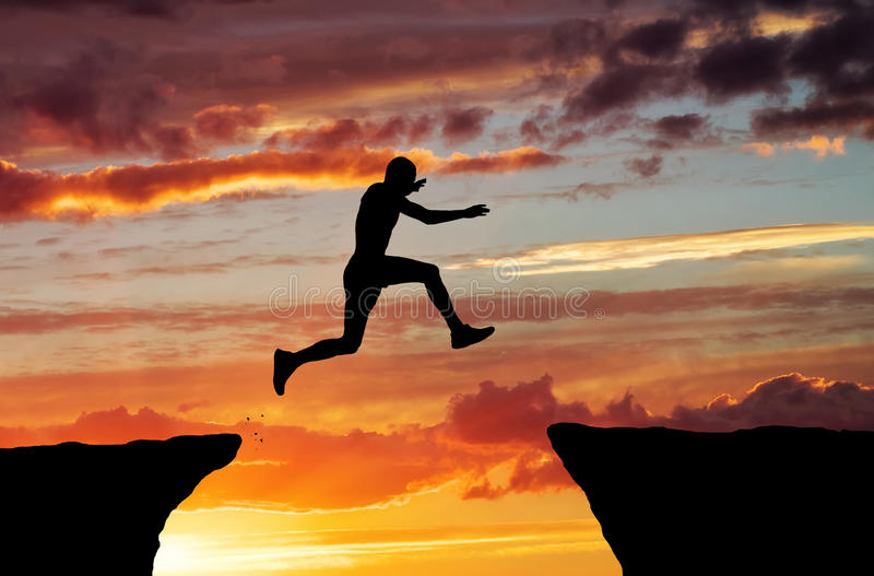 Man jump through the gap. On sunset fiery background. Element of design
