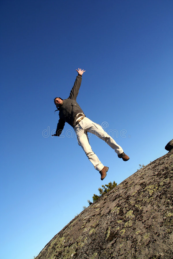 Man Jumping With Arms Wide Open Stock Image