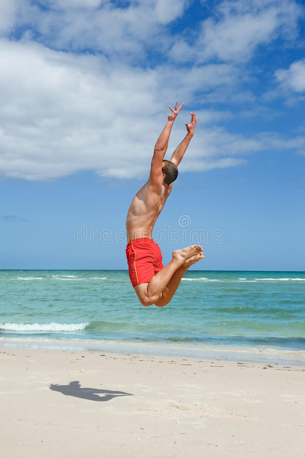Download Man jumping on the beach stock photo. Image of outside - 24401722
