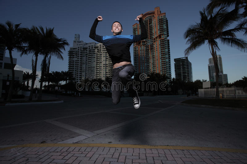 Download Man jumping for joy stock photo. Image of outside, person - 13626814