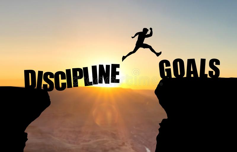 Man jumping over abyss with text DISCIPLINE/GOALS. Man jumping over abyss with text DISCIPLINE/GOALS in front of sunset stock illustration