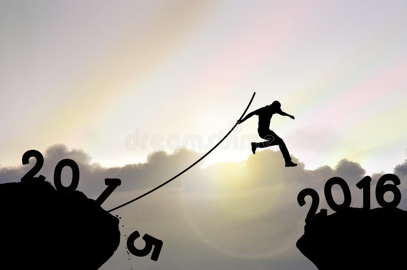 Man jumping over precipice , far in distance with pole vault on stock image