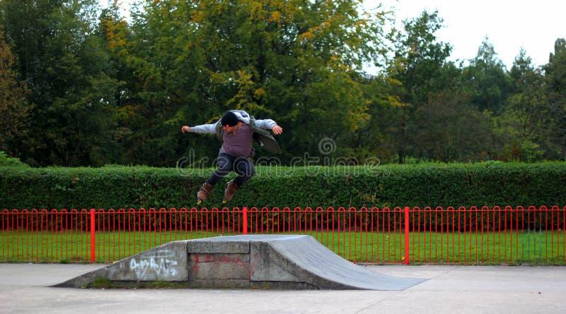 Man Jumping on Rollerskates Ramp royalty free stock photography