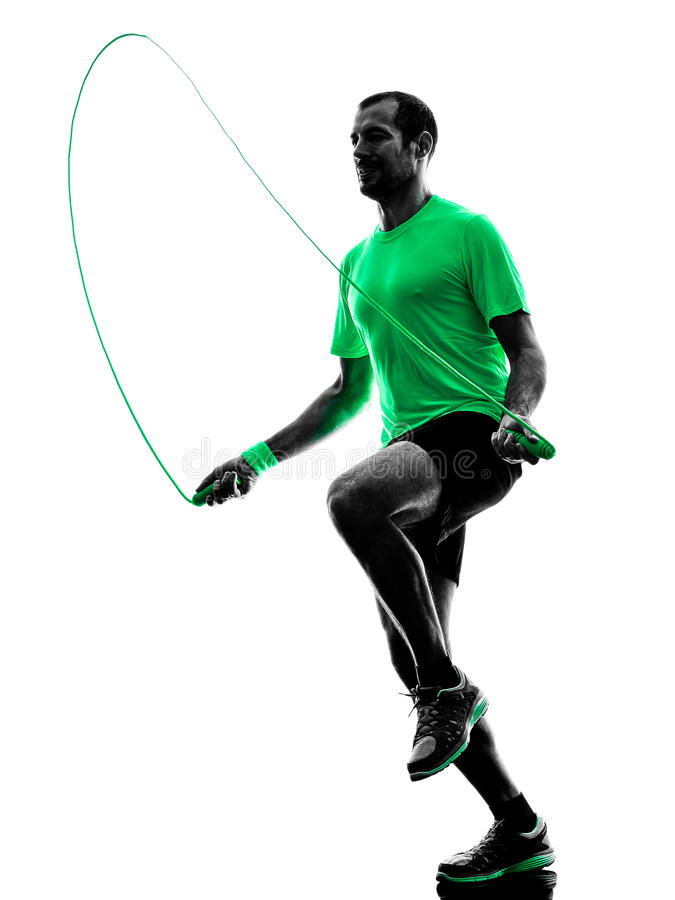 Man jumping rope exercises fitness silhouette. One man exercising jumping rope fitness in silhouette isolated on white background royalty free stock images