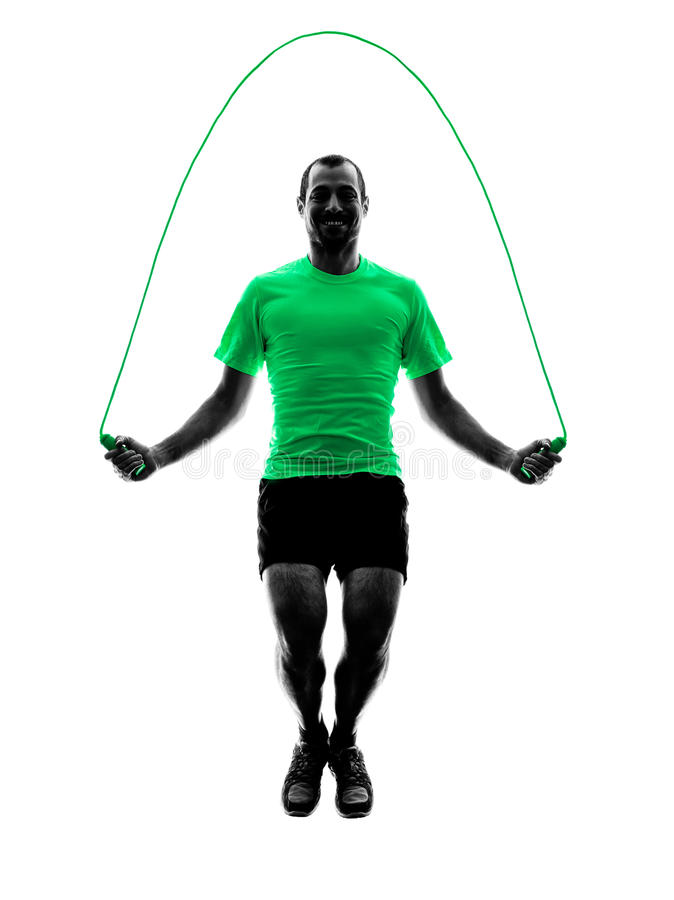 Man jumping rope exercises fitness silhouette. One man exercising jumping rope fitness in silhouette isolated on white background stock photo