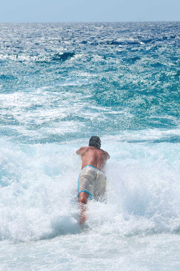 Man jumping in sea stock photography