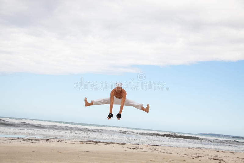 Man is jumping sport karate martial arts fight kick royalty free stock photo