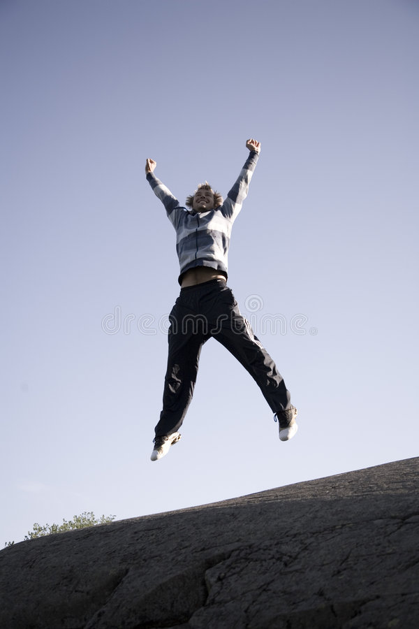 Man jumps stock image