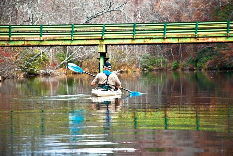 Man in Kayak / Bridge royalty free stock images