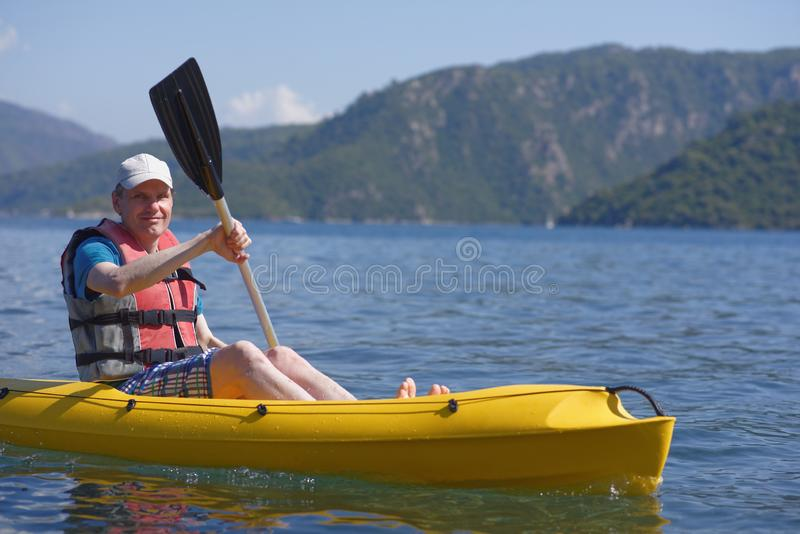 Man in kayak stock photos