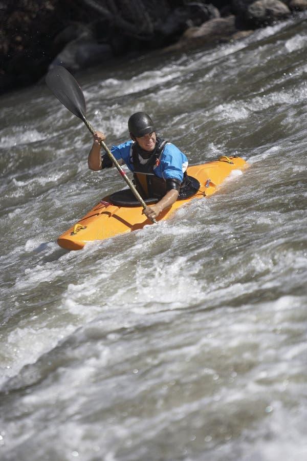 Man Kayaking In Mountain River royalty free stock photos