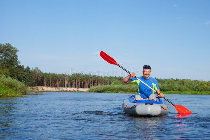 Man kayaking. Summer vacation - Young man kayaking on the river royalty free stock photography